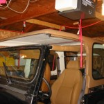 Top hanging above Jeep, from front