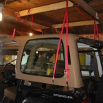Top hanging above Jeep, from rear